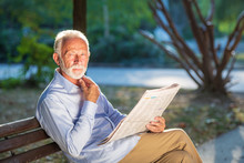 Portrait Of A Senior Man Readi...