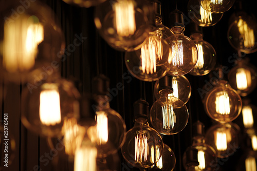 Photographie Lots of vintage light bulbs are blinking