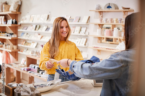 Pinturas sobre lienzo  Female Sales Assistant In Independent Clothing And Gift Store Serving Female Cus