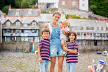 Beautiful Family, Walking On The Streets Of Clovelly, Nice Old Village In The Heart Of Devonshire