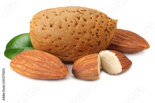 Valokuva  almond with green leaves isolated on white background