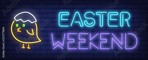 Cuadros en Lienzo Easter weekend neon sign. Chicken with egg shell