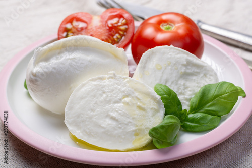 Keuken foto achterwand Buffel Soft white Italian cheese Mozzarella buffalo served with fresh tomato and green basil leaves