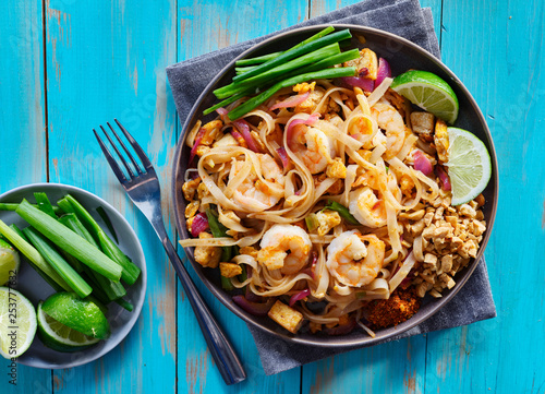 shrimp pad thai on plate in flat lay composition with copy space atop of colorfu Canvas Print