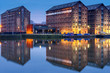 canvas print picture - Gloucester docks warehouses reflected in quay on Sharpness Canal