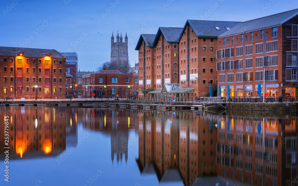 Fototapeta Gloucester docks and Cathedral reflected in the quay on Sharpness at twilight