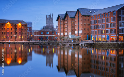 Gloucester docks and Cathedral reflected in the quay on Sharpness at twilight Fototapeta
