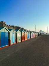 Row Of Beautiful Beach Huts On Brighton And Hove Beach Seafront, Sussex, England
