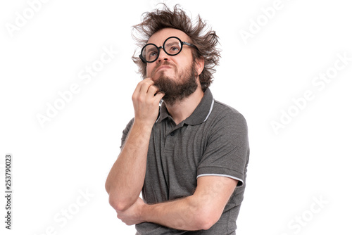 Crazy thoughtful bearded Man with funny Haircut in eye Glasses - ponder and dreaming. Casual thinking guy, isolated on white background. Emotions, and signs concept.