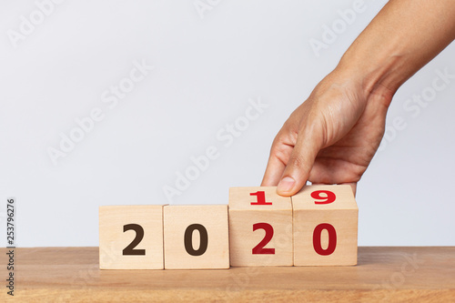 Fototapety, obrazy: Hand flip wooden cube with the word 2019 to 2020 on white background. Concept for success in the future goal and passing time. Happy new year