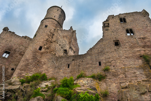 Photo  Impressive low-angle view of the south-western side of Hanstein Castle, one of the largest castle ruins in Central Germany