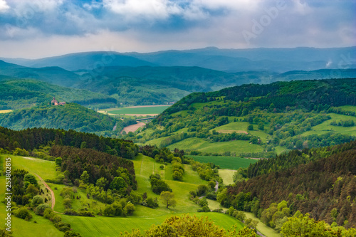 Recess Fitting Green blue Lovely landscape view of the Werra Valley, the Hessian low mountains and the Ludwigs Castle on the far left. Taken from the famous Hanstein Castle, one of the largest castle ruins in Central Germany.