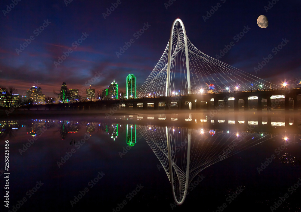 Dallas skyline and famous MHH bridge reflecting w/moon