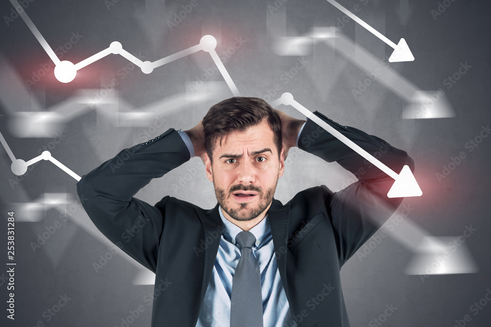 Fototapeta Confused businessman, falling graphs