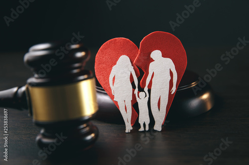 Family figure and gavel on table. Family law concept Wallpaper Mural
