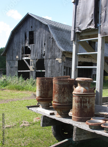 Vintage Milk Cans on a hay wagon - Buy this stock photo and