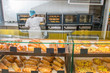 bakery products on display against the background of ovens in the bakery