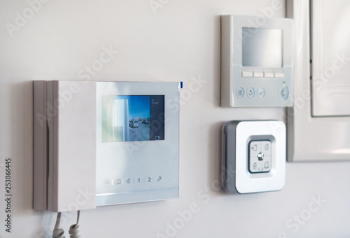 Fototapeta  Close up wall with security alarm and video intercom