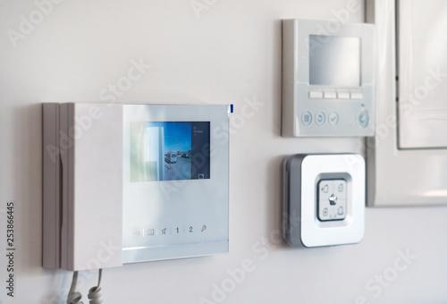 Fotografie, Obraz  Close up wall with security alarm and video intercom