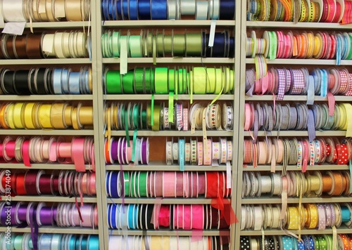 sewing haberdashery haberdasher ribbon reels rolls rows and trims in fabric retail shop  sew sewing supplies for sale retail shop market rainbow stock, photo, photograph, image, picture,