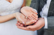 canvas print picture - Two wedding rings on bride and groom's palms. Bride and groom holding wedding rings on their palms during ceremony. Close up.