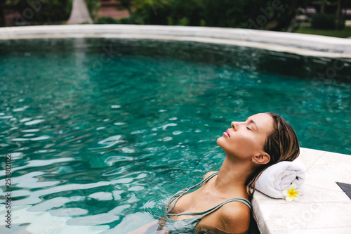 Photo sur Toile Kiev Woman relaxing in swimming pool