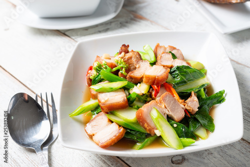 Crispy Pork Belly Stir Fry With Chinese Kale - Buy this stock photo