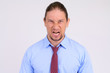 Face of angry businessman shouting against white background