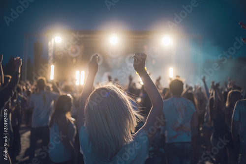 Photo  BAD AIBLING, GERMANY: girl in front of a stage on a festival in Mai 2017