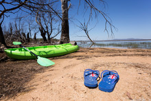Australian Themed Thongs With A Kayak In The Background For Australia Day Themes.