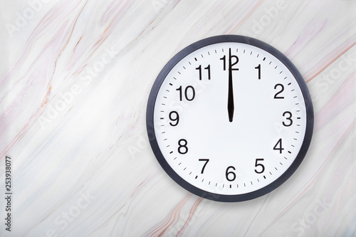 Wall clock on marble texture show twelve o'clock Canvas Print