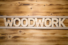 WOODWORK Word Made With Building Block Letters On Wooden Board.