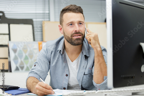 craftsman using the phone Canvas Print
