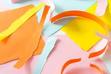 Torn Off Scraps Of Colored Paper.