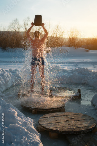 ice bucket shower. winter swimming.