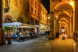 canvas print picture - Old narrow street with arcade in Bologna, Emilia Romagna, Italy. Night cityscape of Bologna.