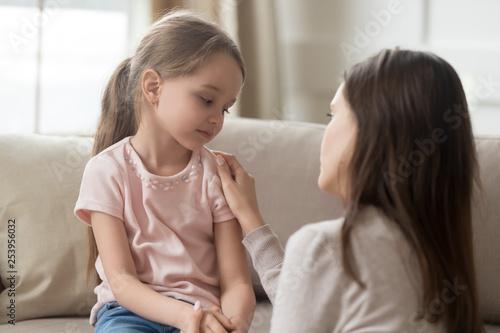 Loving mom talking to upset little child girl giving support Fototapet