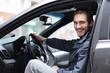 successful man behind the wheel of a car.