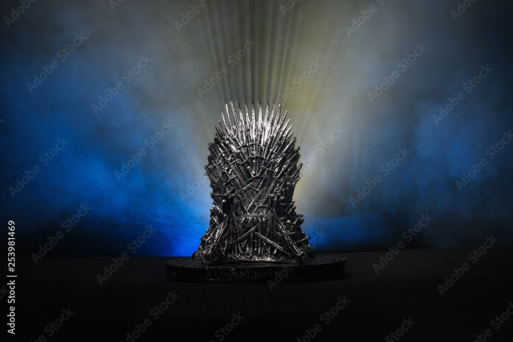 Fototapeta The model of throne as in Game of throne at a bright blue smoke background