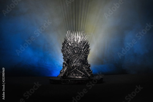 The model of throne as in Game of throne at a bright blue smoke background Fototapet