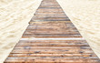 Panorama of deserted sandy beach with a wooden pathway in Anapa, Russia