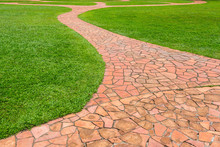 Orange Stone Walkway With Green Grass In Park. Abstract Background.
