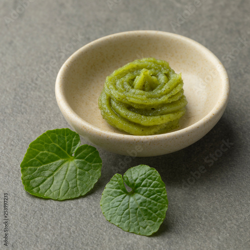 Dish with traditional Japanese horseradish paste and wasabi leaves Wallpaper Mural