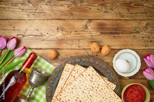Jewish Holiday Passover Background With Matzo Seder Plate Wine And Tulip Flowers On Wooden Table Buy This Stock Photo And Explore Similar Images At Adobe Stock Adobe Stock