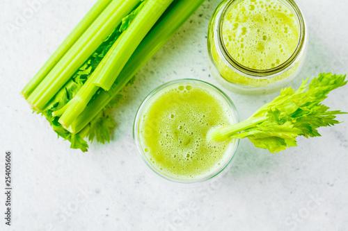 Green detox celery juice in a glass.
