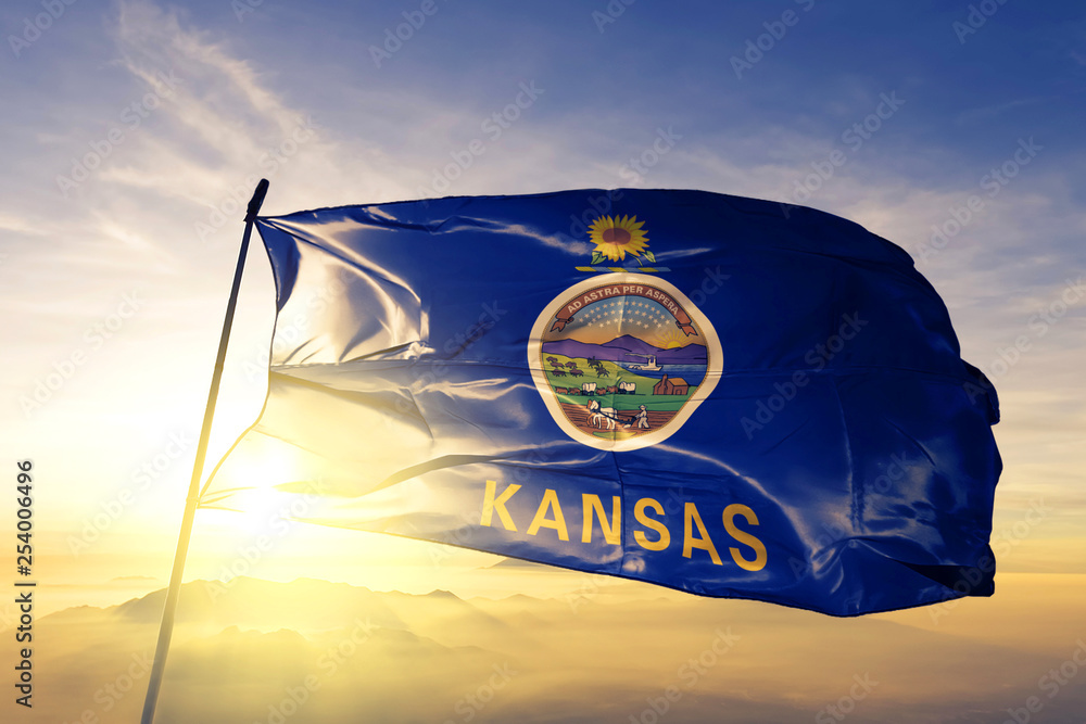 Fototapety, obrazy: Kansas state of United States flag waving on the top sunrise mist fog