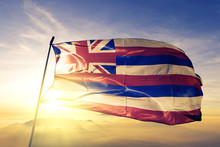 Hawaii State Of United States Flag Waving On The Top Sunrise Mist Fog