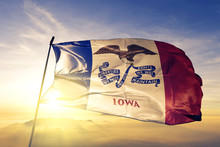 Iowa State Of United States Flag Waving On The Top Sunrise Mist Fog