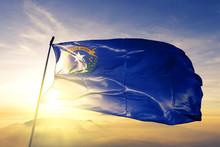 Nevada State Of United States Flag Waving On The Top Sunrise Mist Fog