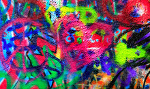 Detail Of Bright Colorful John Lennon's Wall With Graffiti In Prague